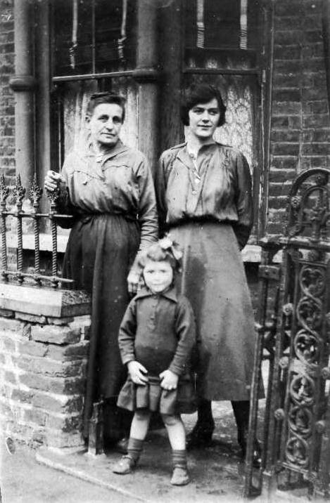 Sarah Bowyer, daughter & lodger Olga Clasper outside their home on Seyssel St (much later than Booth's work, c1920)