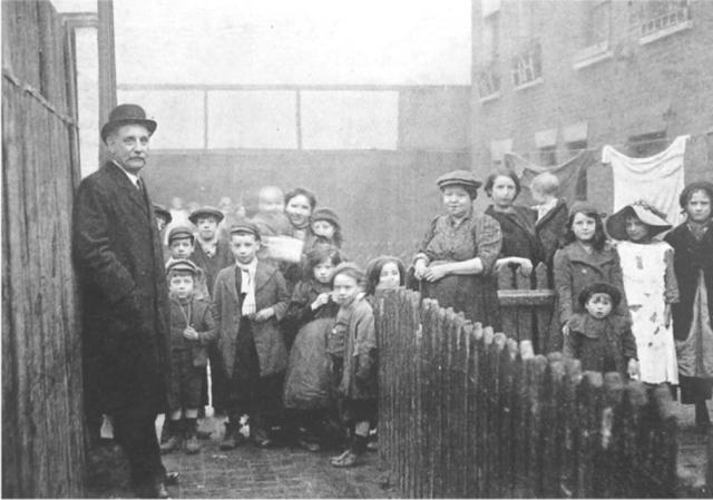 George Lansbury visiting Poplar slum housing