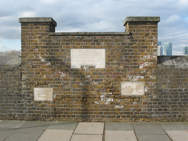 Thames_flood_level_markers_at_Trinity_Hospital_Greenwich