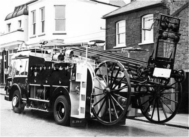The ERF pump escape attached to Millwall fire station, the latest addition to the Brigade's appliance fleet. It was a dual-purpose appliance that could carry either the 50 foot wheeled escape ladder or the 30 foot extension ladder. In addition the fire engine pictured is carrying two hook ladders, and a first floor ladder which could be attached to the escape ladder to give it extra height. 1973